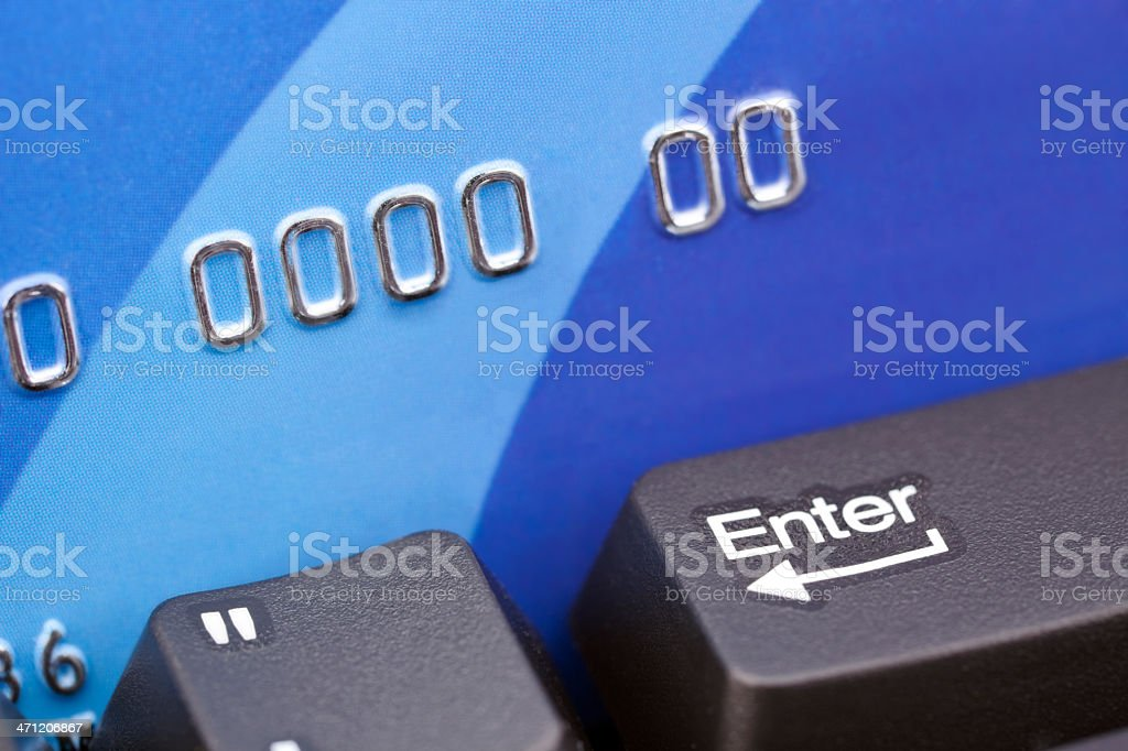 Credit Card on Computer Keyboard With Enter Key royalty-free stock photo
