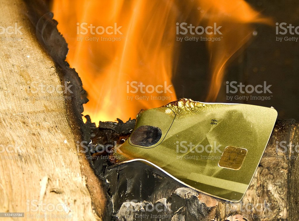 Credit card on fire stock photo