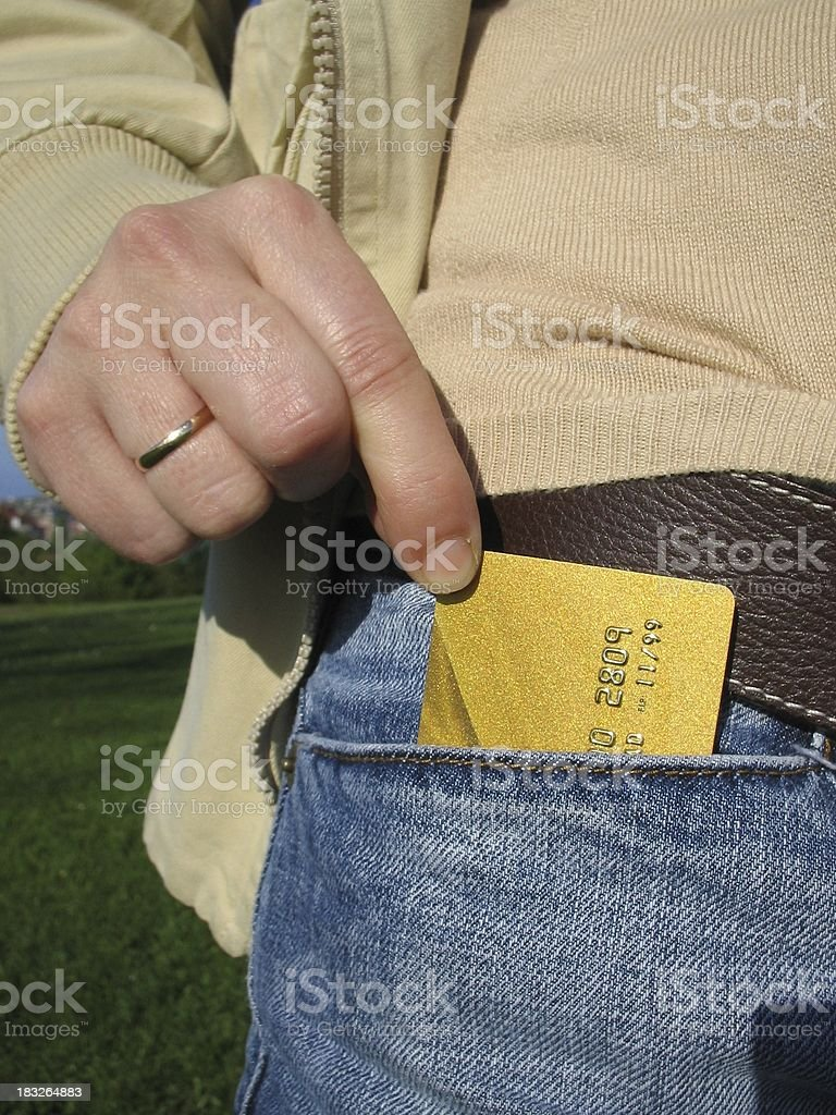Credit card on jeans stock photo