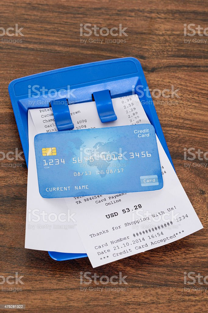 Credit Card On Shopping Bill stock photo