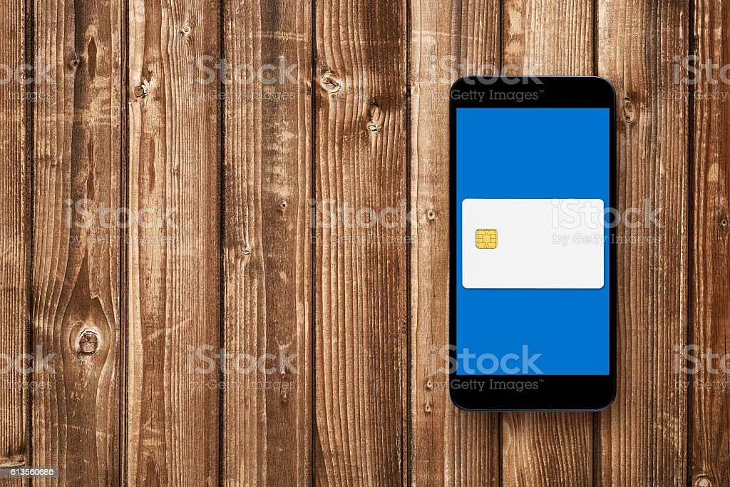 Credit card on smartphones screen - mobile wallet concept stock photo