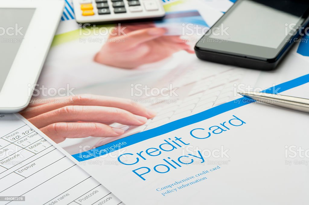 Credit card policy document with paperwork stock photo