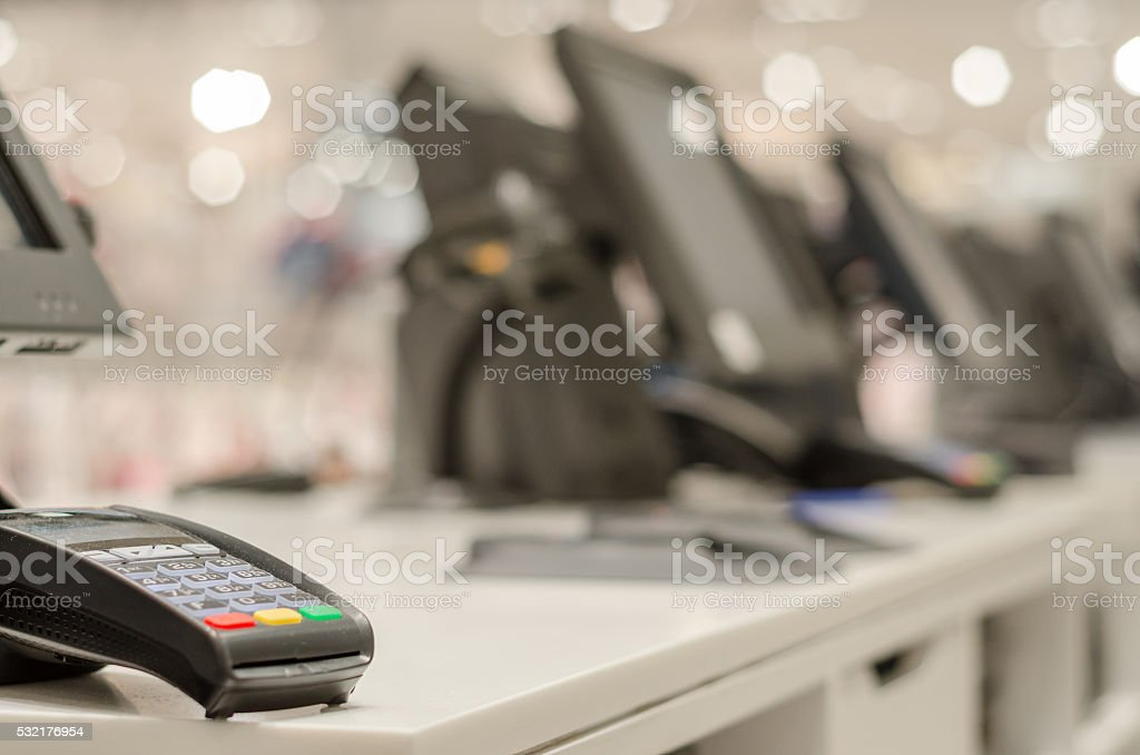 Credit card reader at the table stock photo