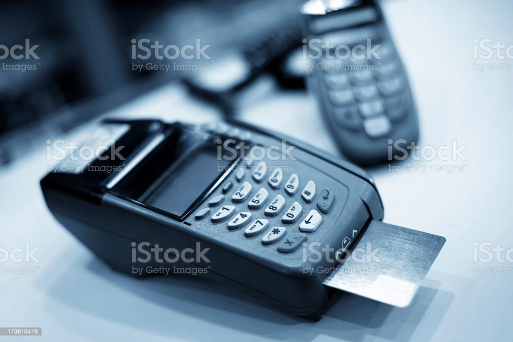 A credit card reader with a chip and pin slot royalty-free stock photo