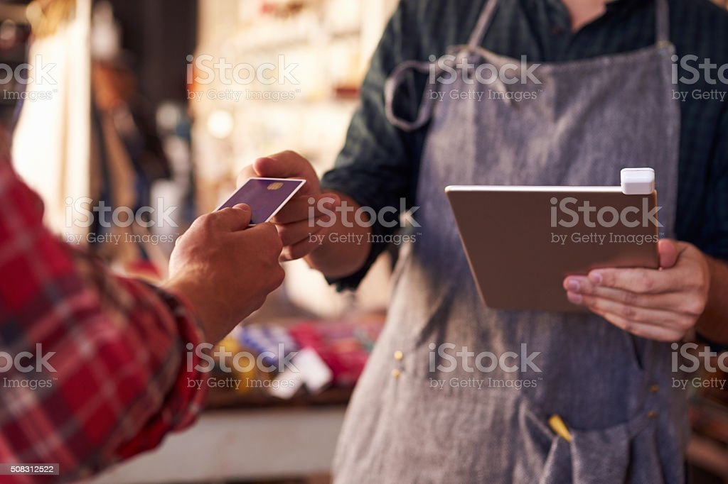 Credit Card Reading Device Attached To Digital Tablet stock photo