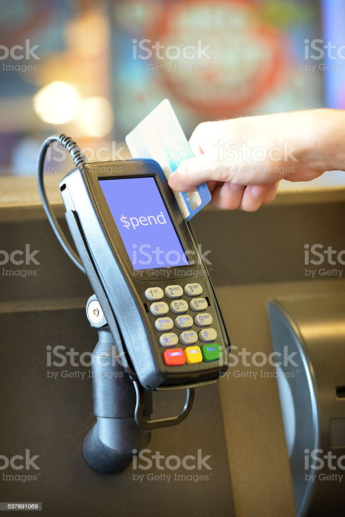 Credit card swiping through eftpos machine with words stock photo