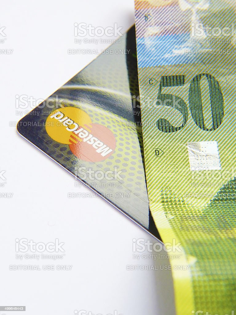 Credit card with 50 francs banknote stock photo