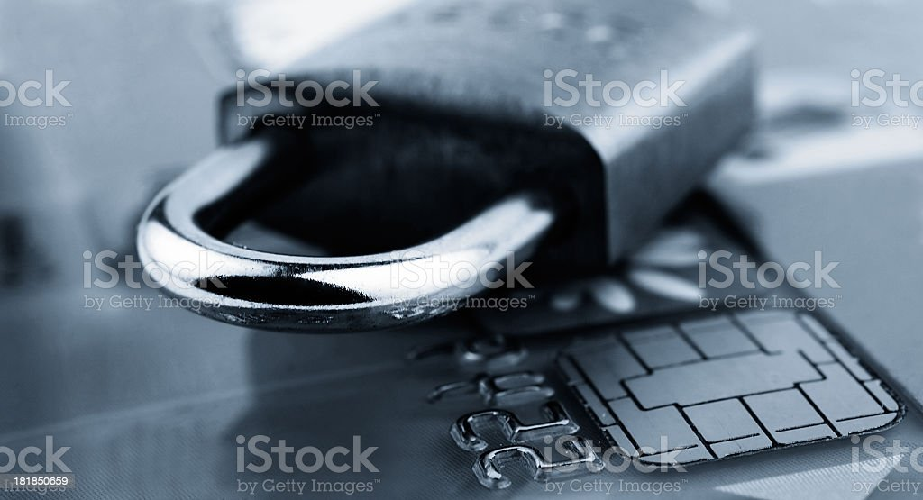 Credit card with locked padlock on top representing security stock photo
