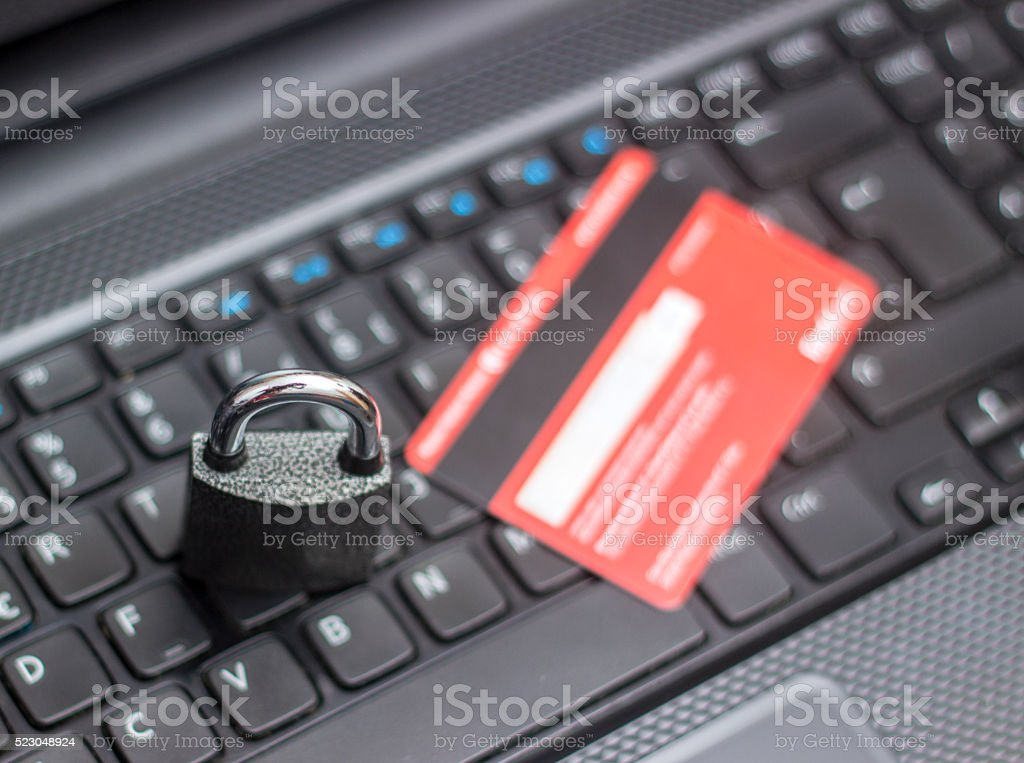 Credit card with security lock on computer keyboard stock photo