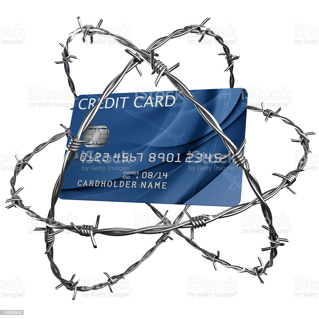 Credit card wrapped in barbed wire royalty-free stock photo