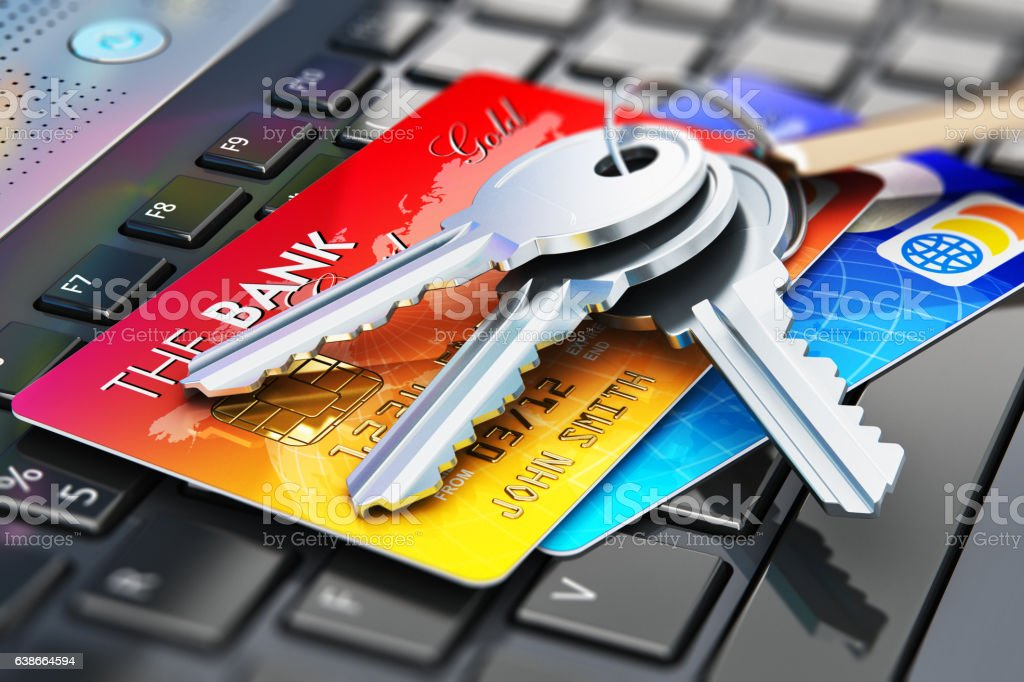 Credit cards and house keys on laptop keyboard stock photo