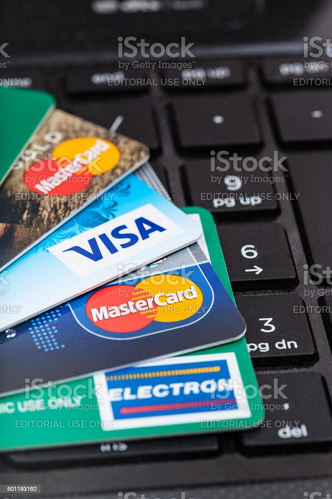 credit cards on black computer keyboard stock photo