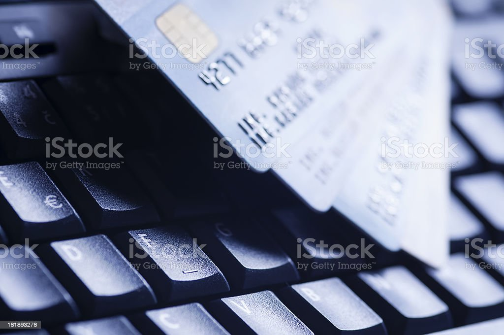 Credit cards on computer keyboard royalty-free stock photo