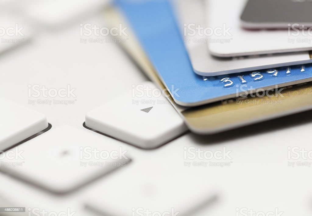 credit cards on computer keyboard stock photo
