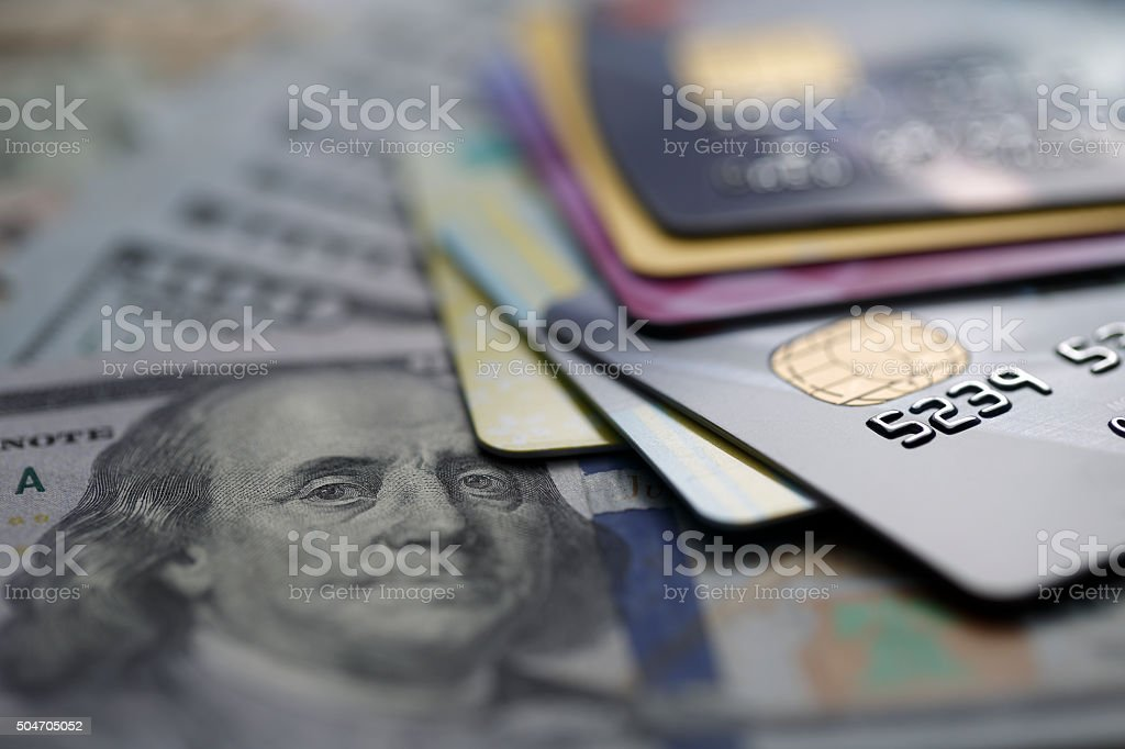 credit cards on dollars stock photo