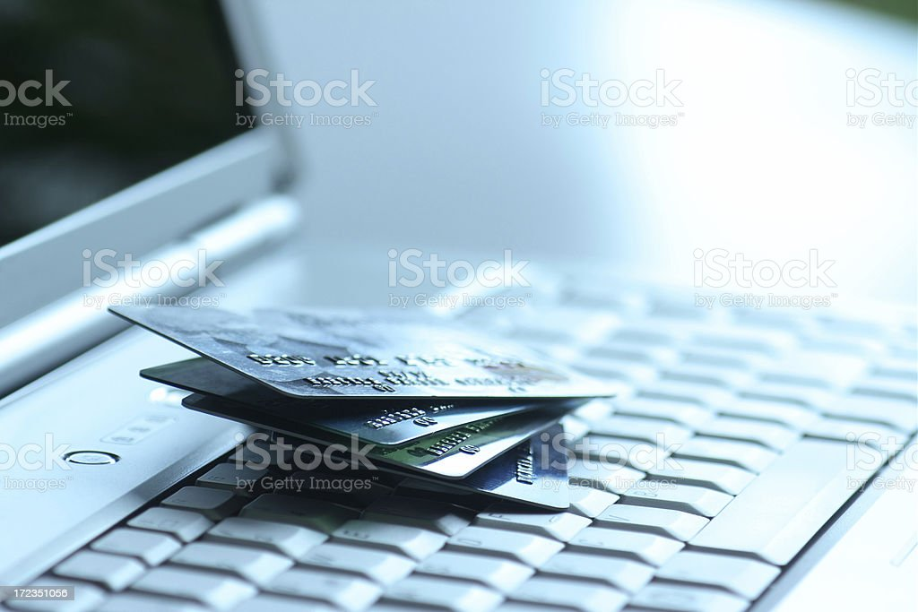 credit cards on silver laptop royalty-free stock photo