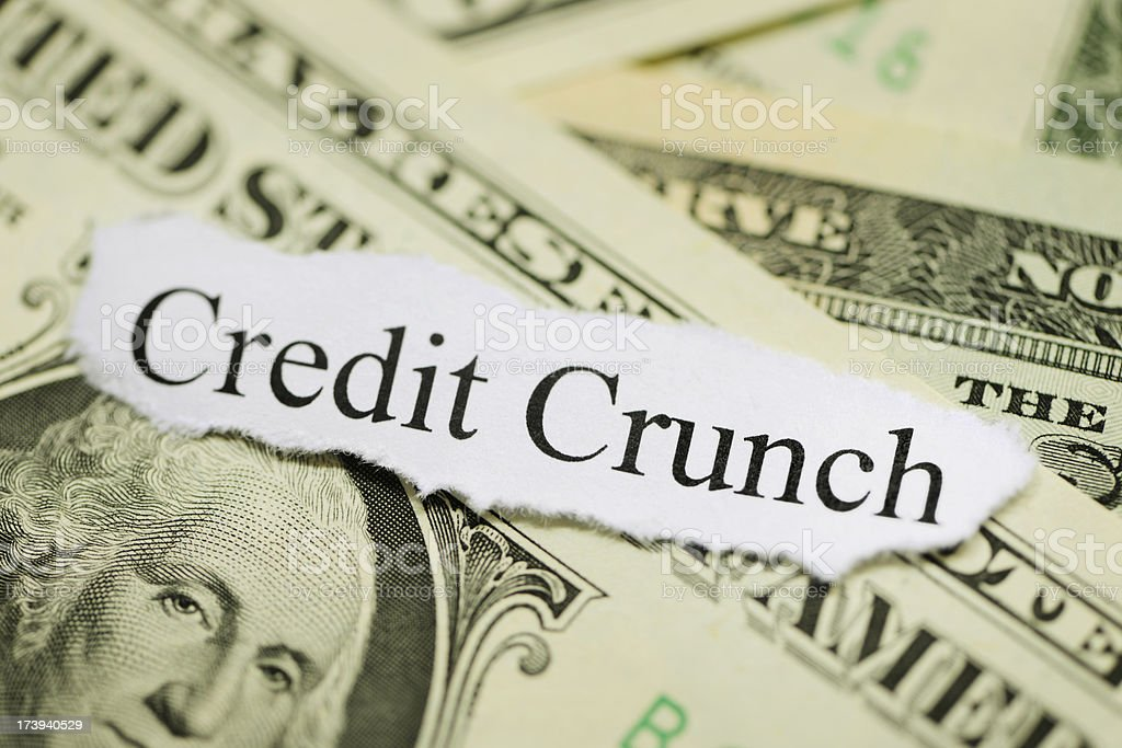 Credit crunch headline on dollar bills backdrop royalty-free stock photo