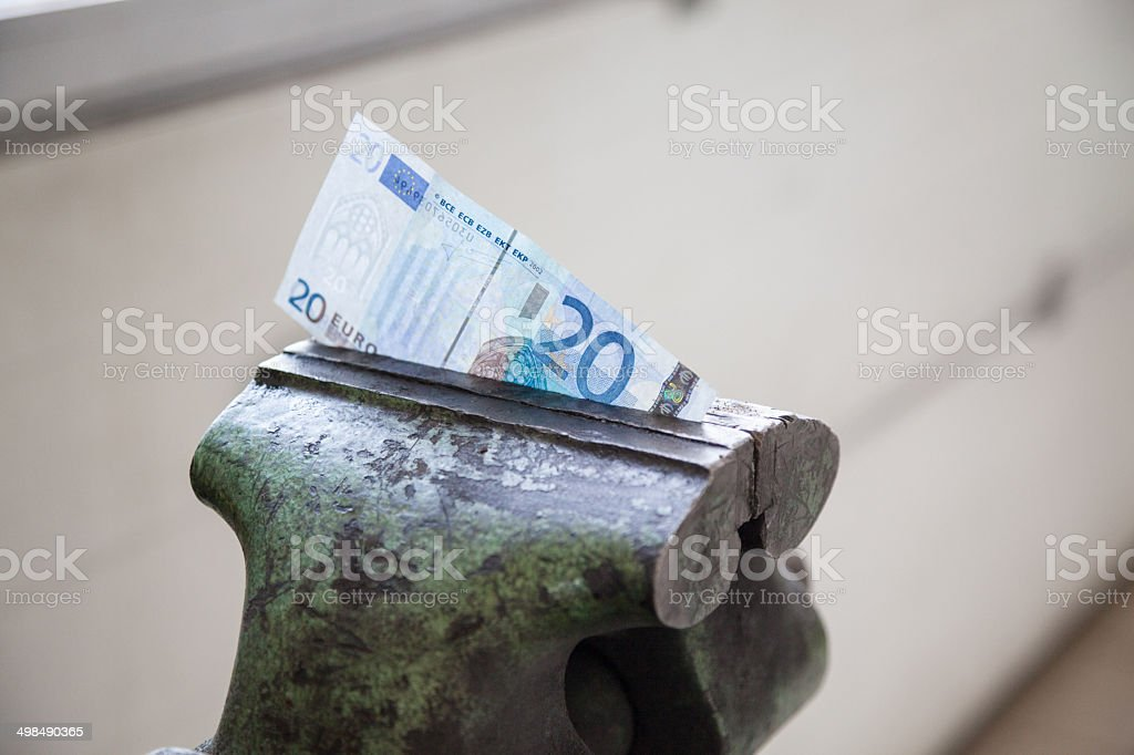 credit crunch vice squeeses money royalty-free stock photo