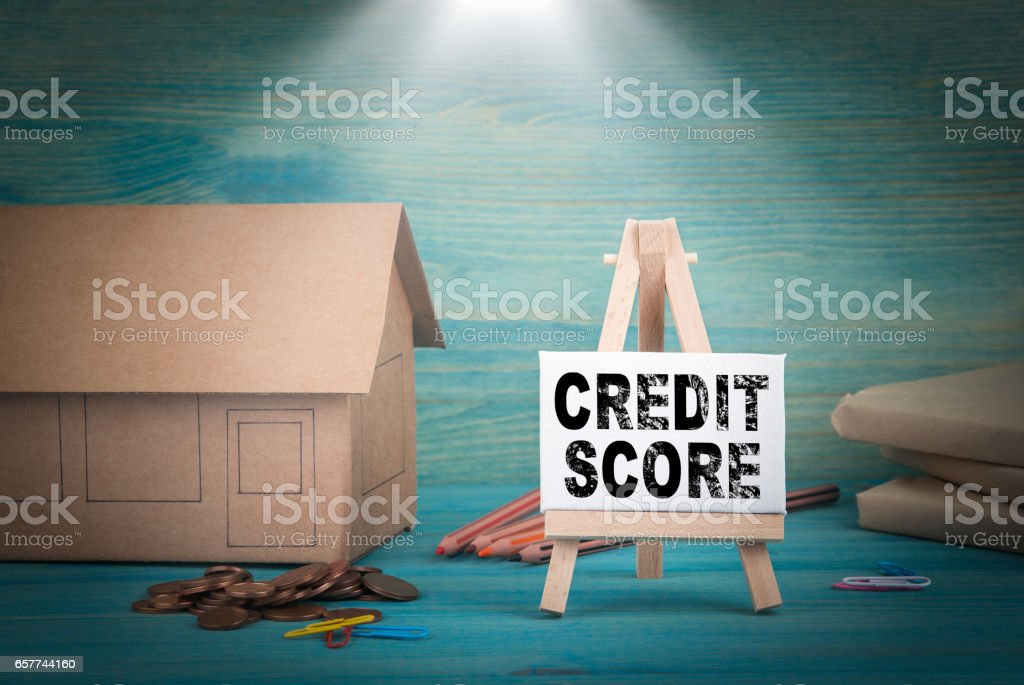 credit score. home model, money and a notice board under the sunlit stock photo