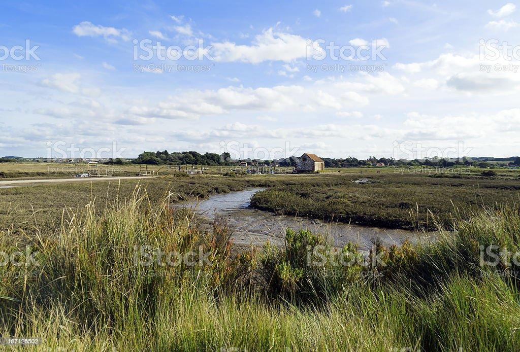 Creek at low tide, Thornham, Norfolk royalty-free stock photo