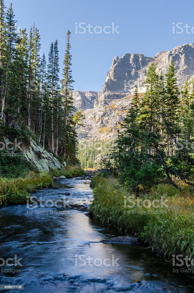 Creek Runs Beneath the Little Matterhorn in Colorado stock photo