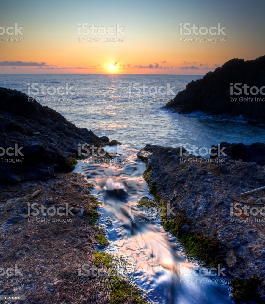 Creek to the Ocean at Sunset royalty-free stock photo