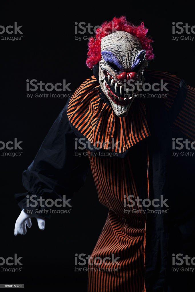 Creepy Adult Clown Halloween Costume Portrait on Black royalty-free stock photo