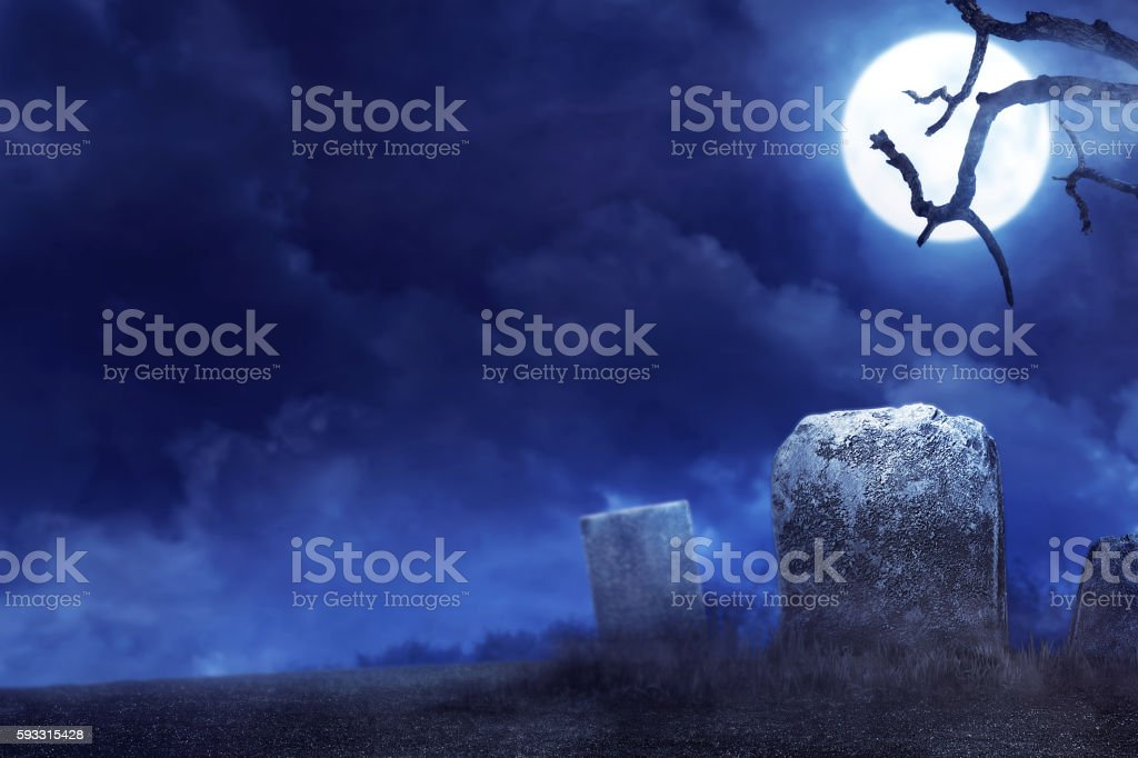 Creepy atmosphere in the cemetery in the night stock photo