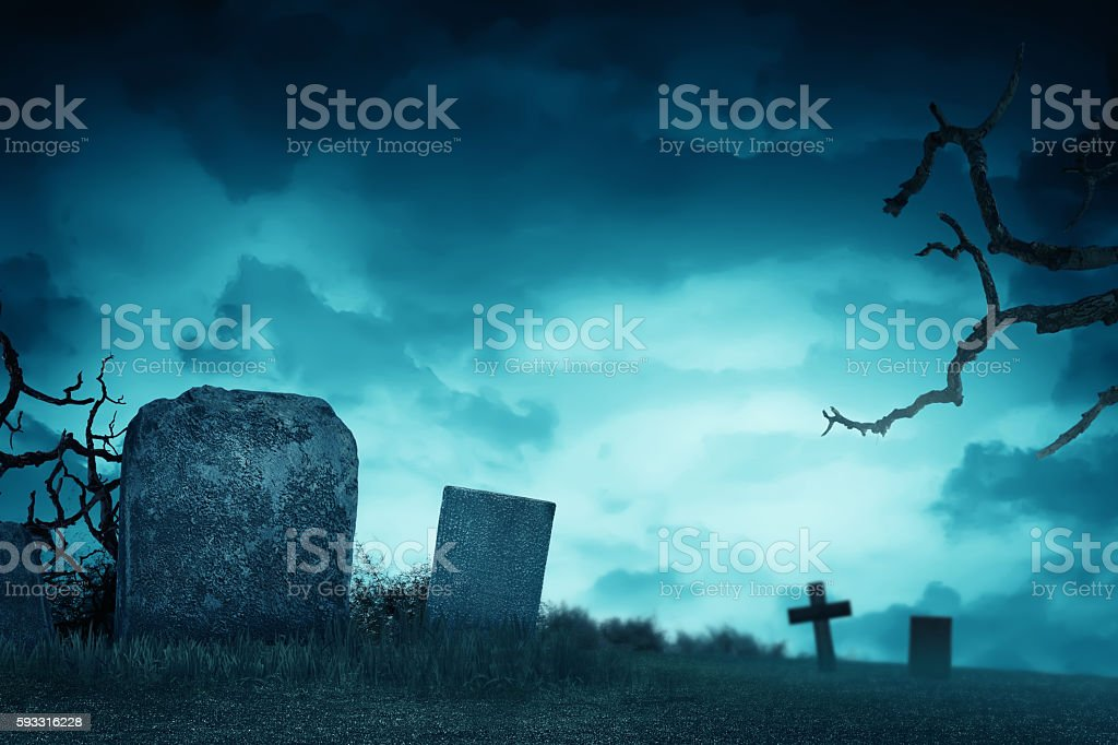 Creepy atmosphere in the cemetery with tombstone stock photo