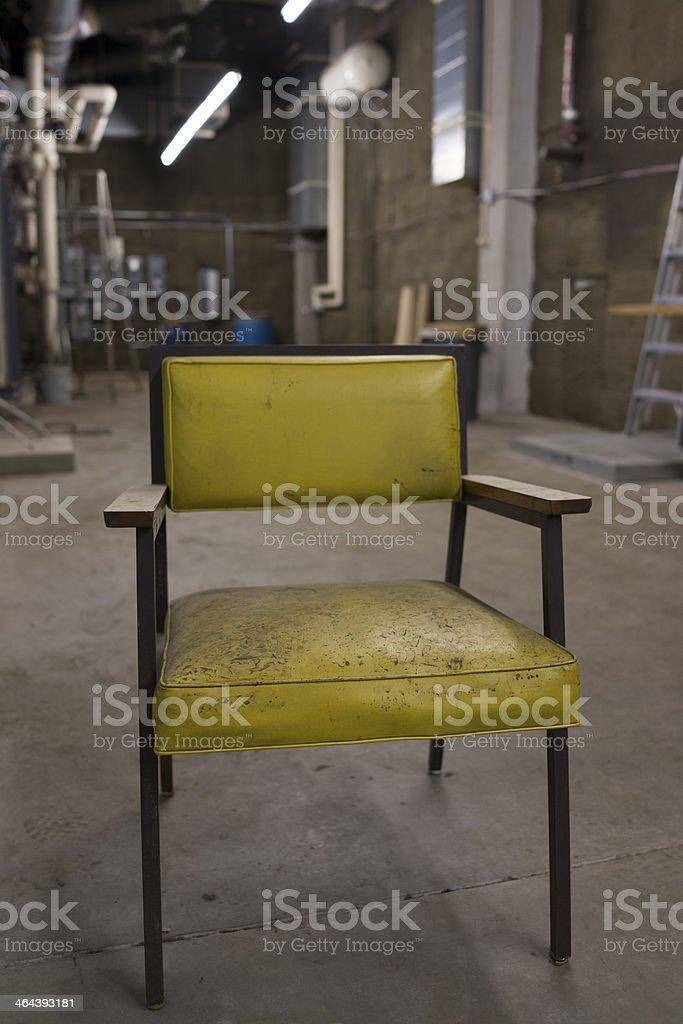 Creepy Chair in Basement stock photo