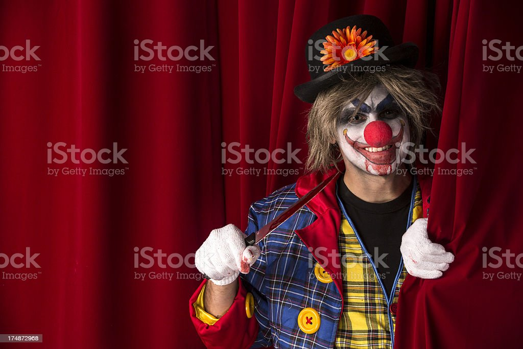 Creepy Clown behind the curtain royalty-free stock photo