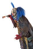Creepy Clown holding a brass horn