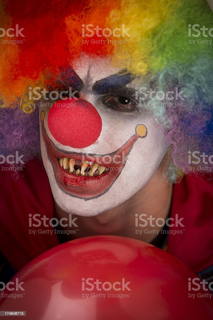 Creepy Clown over a red ball royalty-free stock photo