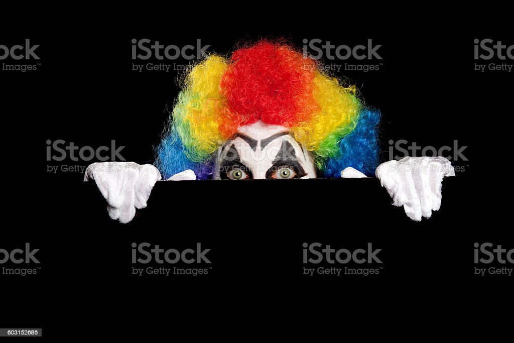 Creepy Clown Peeking At You stock photo