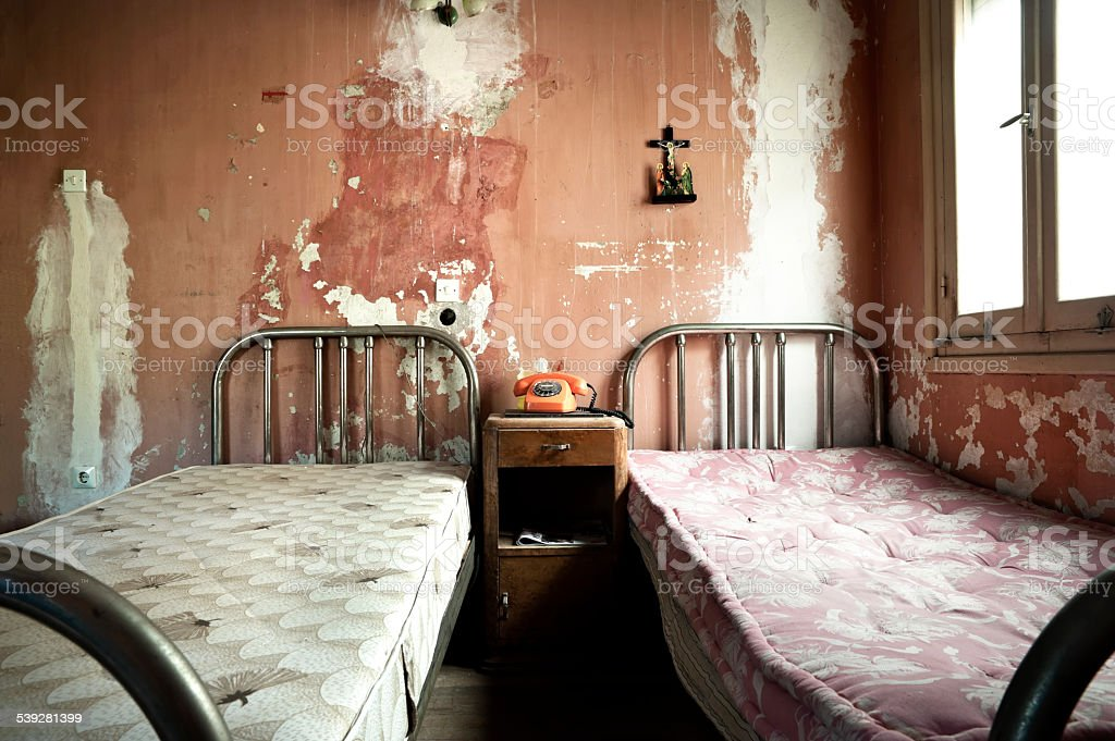 Creepy dirty and abandoned bedroom stock photo