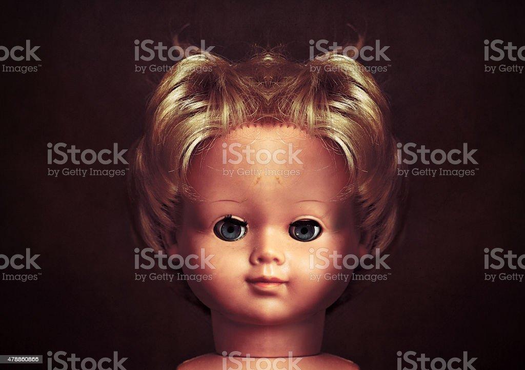 Creepy doll face stock photo