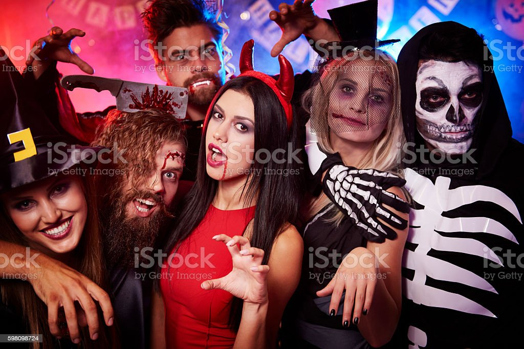 Creepy faces made by party people stock photo