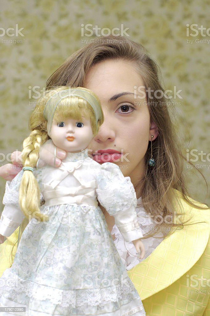 Creepy girl and doll portrait royalty-free stock photo