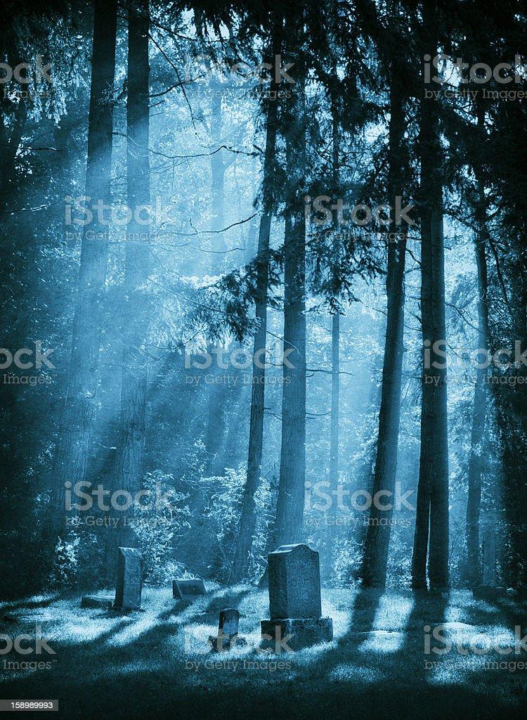 A creepy graveyard at night time royalty-free stock photo