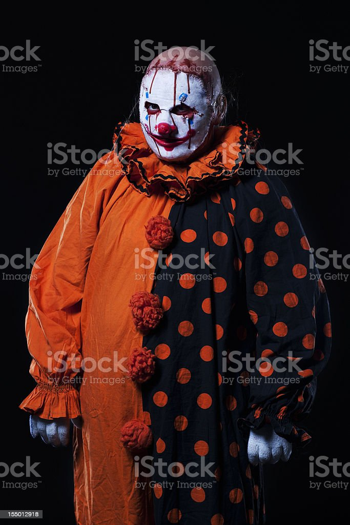 Creepy Halloween Clown in Bloody Mask, Portrait on Black stock photo