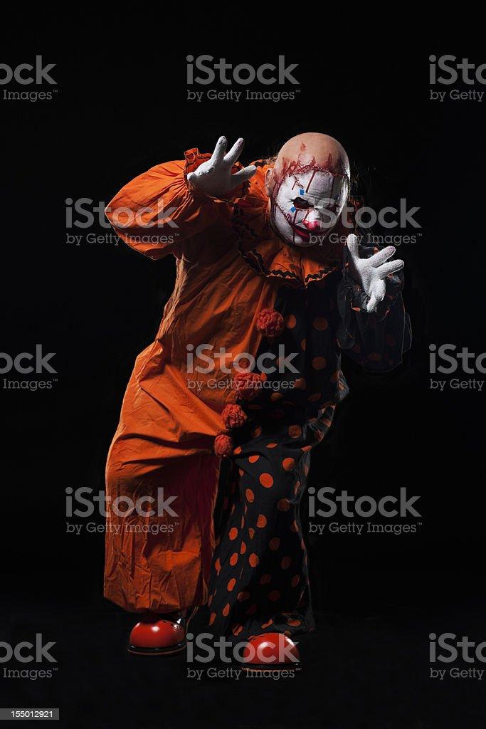 Creepy Halloween Clown in Bloody Mask, Portrait on Black royalty-free stock photo