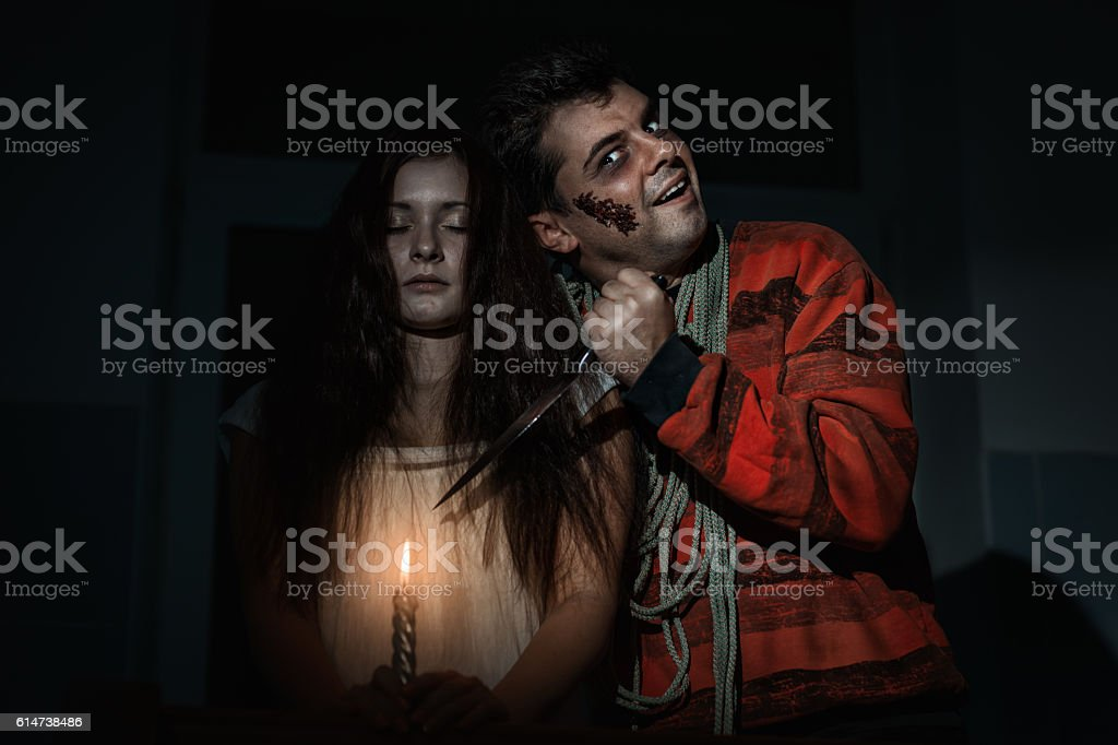 Creepy man and a woman. stock photo