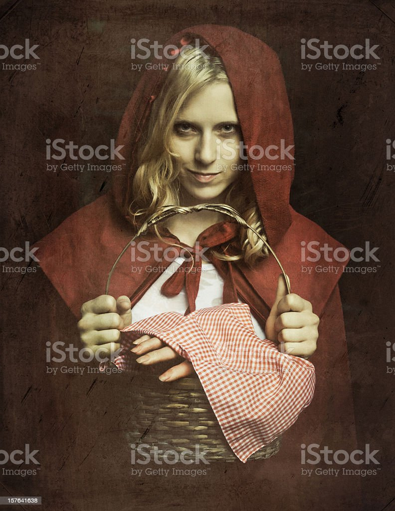 Creepy not so Little Red Riding Hood stock photo