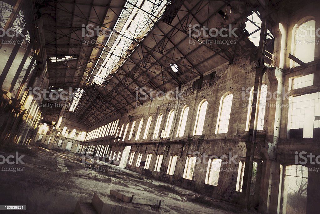 Creepy old factory inside hangar royalty-free stock photo