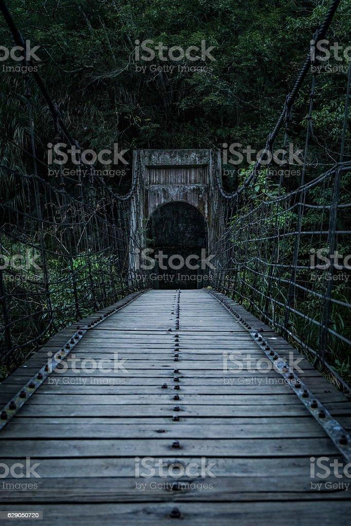 Creepy Old Suspension Bridge stock photo