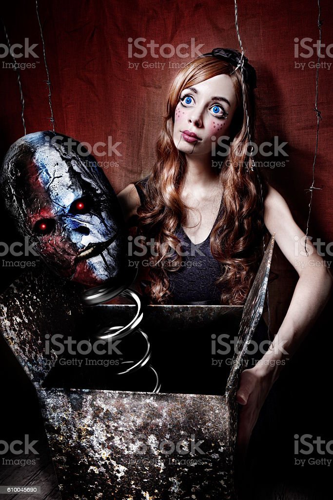 creepy puppet in horror house stock photo