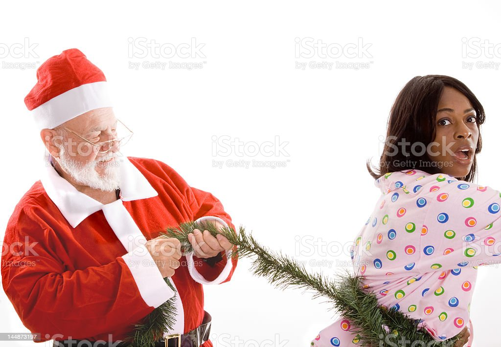 Creepy Santa African American Woman Wrapped in Garland, Isolated Background royalty-free stock photo