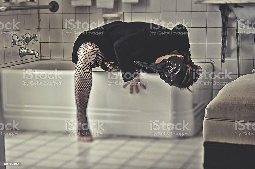 Creepy woman wearing a bizarre mask royalty-free stock photo