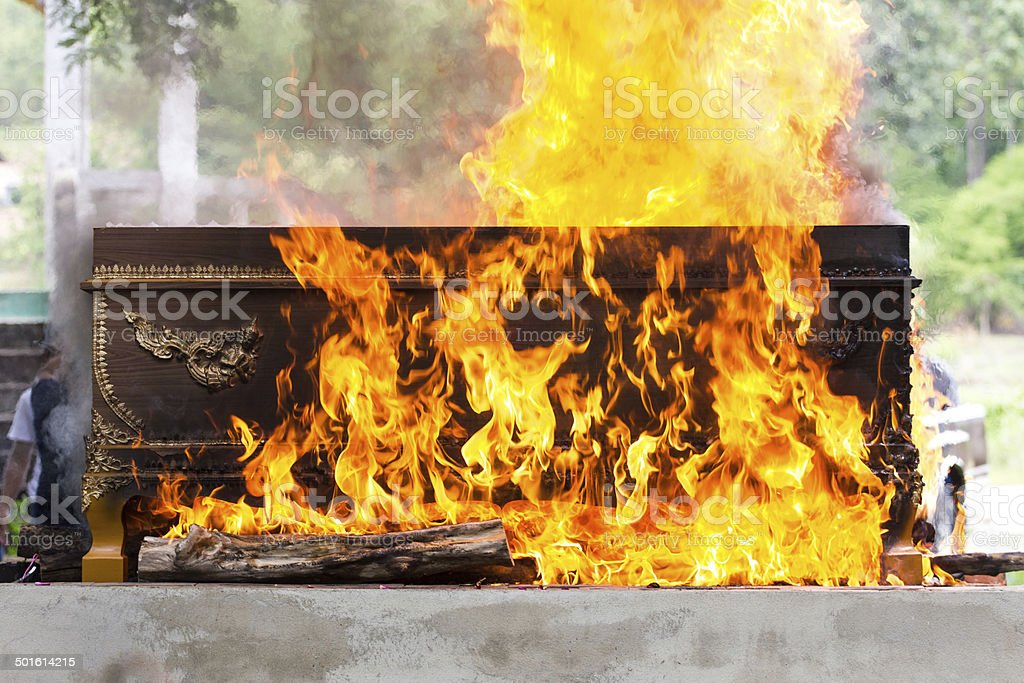 cremation at graveyard in thailand, coffin burning. stock photo