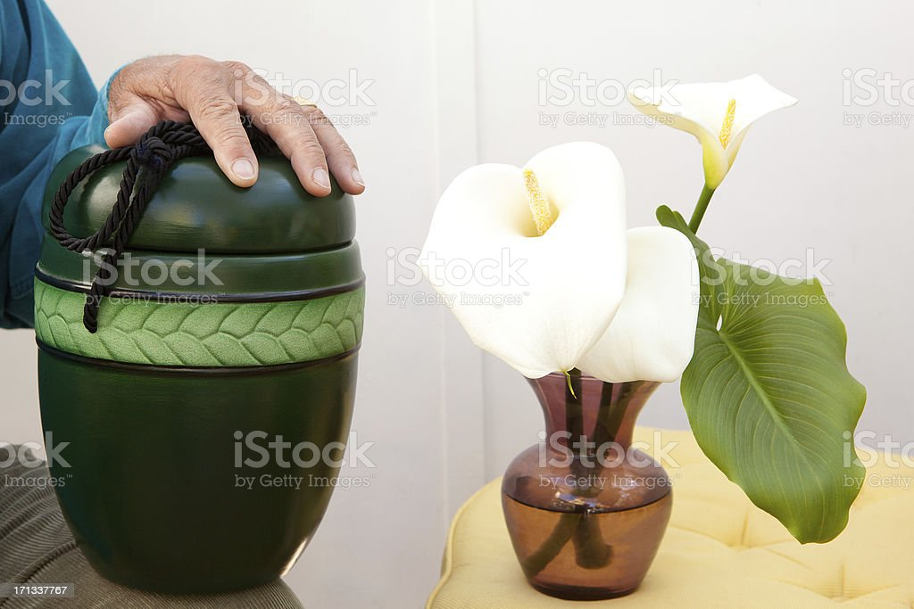 Cremation box and flowers stock photo